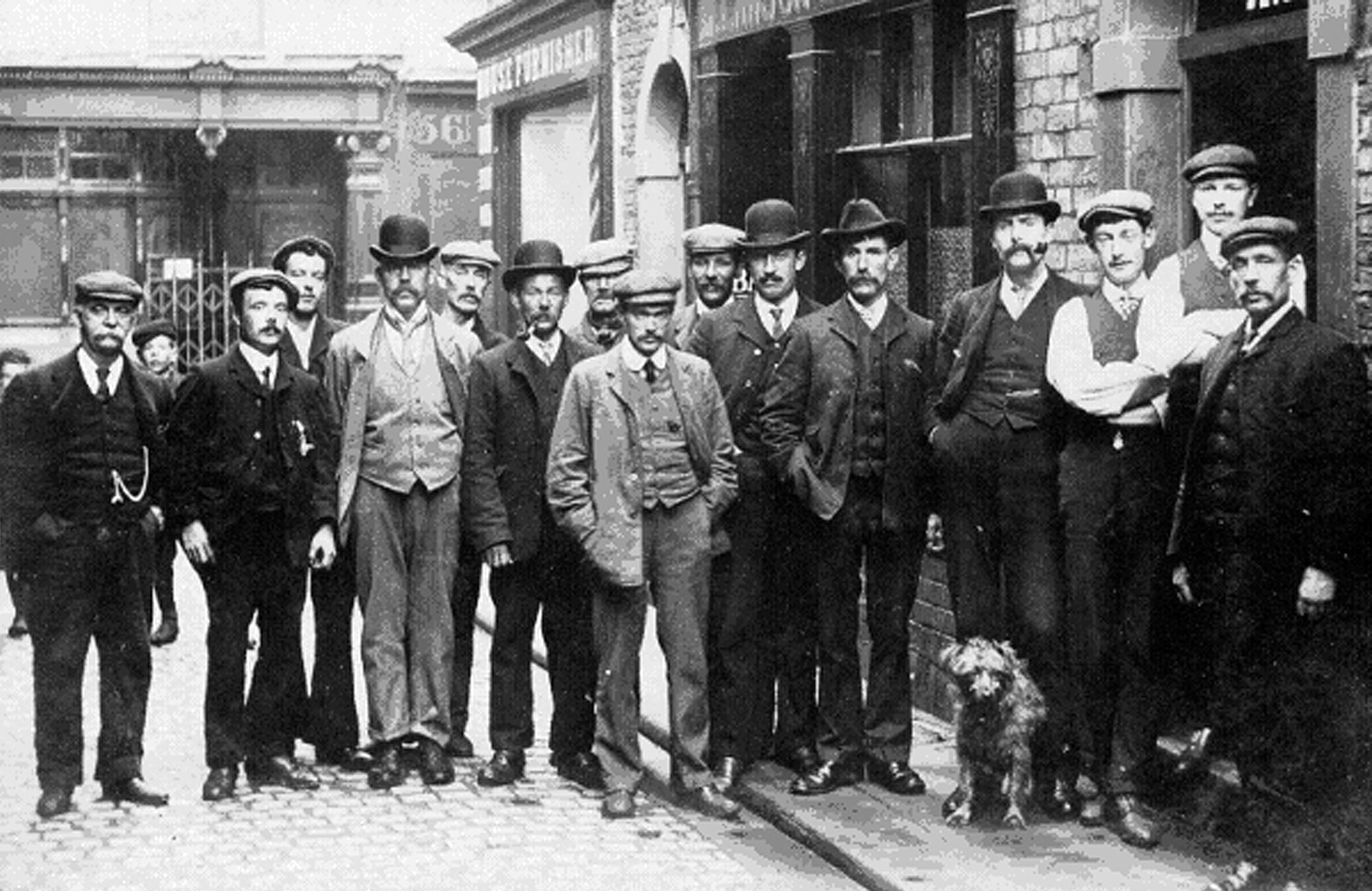Men posing on Fisher Street